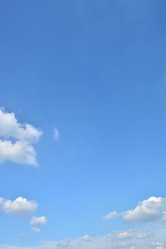 Blue Sky With Scattered Clouds With A Sun