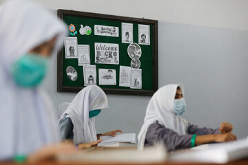 A welcome sign is seen on a notice board of a class as schools reopen amid the coronavirus disease (COVID-19) pandemic, in Karachi