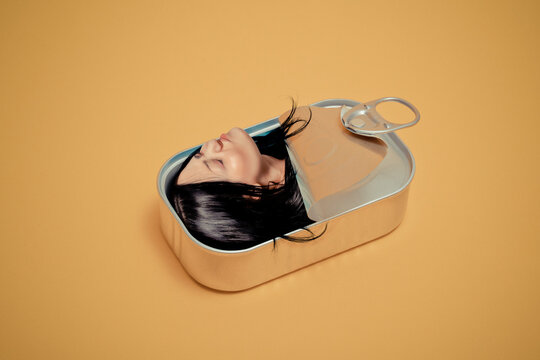 Woman with eyes closed stuck in tin can box