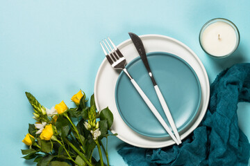 Spring table setting with flower top view.
