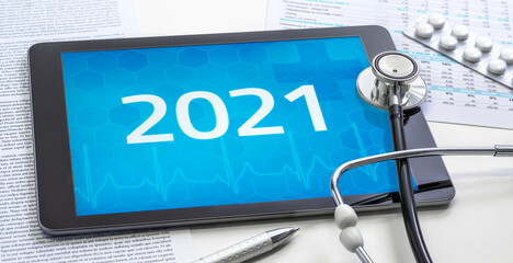 A tablet with the number 2021 on the display