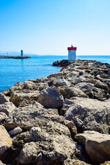 Two lighthouses located on the rocks of the breakwaters that protect the entrance to the marina.