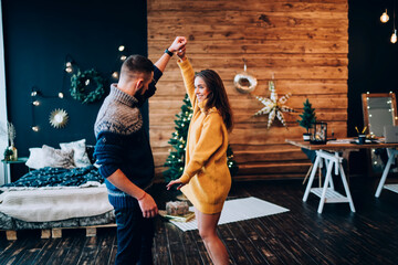 Couple dancing at home on Christmas eve
