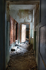 Corridor of the living area in an old abandoned building