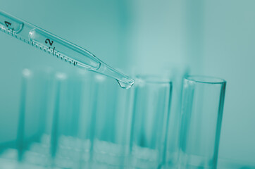 Pipette dropping a sample into a test tube and science experiments ,Laboratory glassware containing chemical liquid