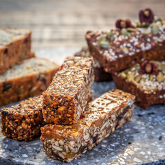Healthy seeded protein bars with nuts are arranged on display