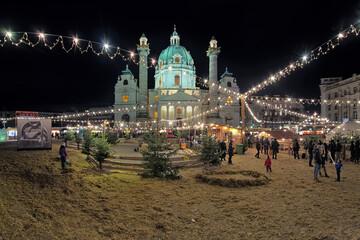 Vienna, Austria. Karlsplatz Christmas market with children's area in front of Karlskirche.