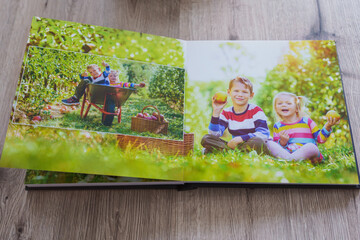 Family photos archive saved in brightly designed photo book