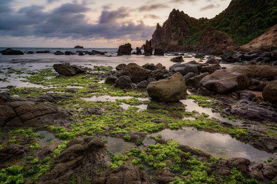 Volcanic rocks boulder sitting in Watulumbung beach, Gunung Kidul, Yogyakarta, Indonesia