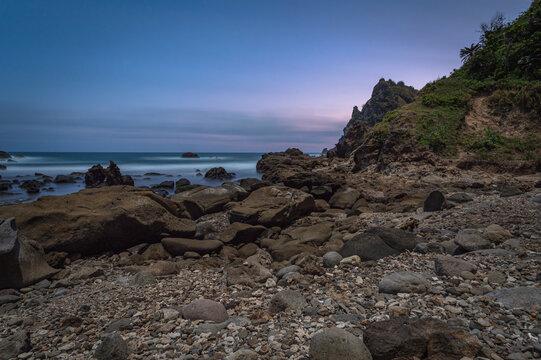 Soft blue sky after sunset in Watulumbung beach in Gunung Kidul, Yogyakarta, Indonesia