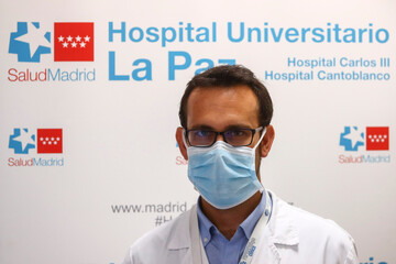 Alberto Borobia, lead investigator of Hospital La Paz, poses for a picture before an interview with Reuters in Madrid