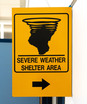Yellow sign indicating a severe weather shelter area