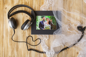beautiful picture of bride and groom and headphones
