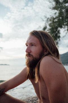 Man with long hair and beard