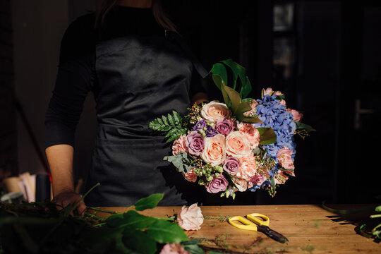 Florist holding a beautiful colorful bouquete