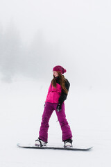Woman Snowboarding on a foggy day