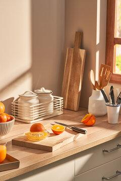 Orange juice preparation in kitchen