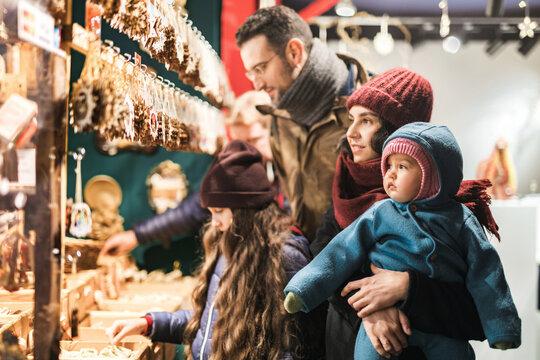Family of four shopping on Christmas Market