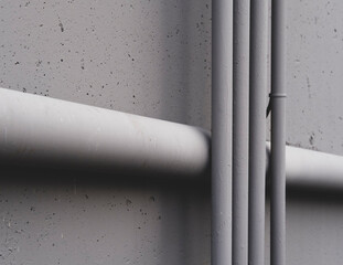 Electrical piping and drainage pipe on building wall