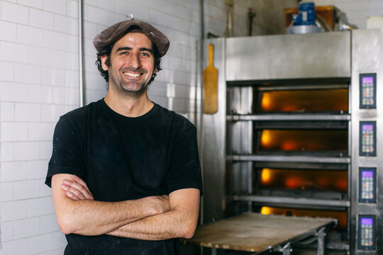 Cheerful bakery owner looking at camera