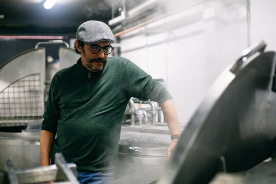 Man watching brewing process on factory