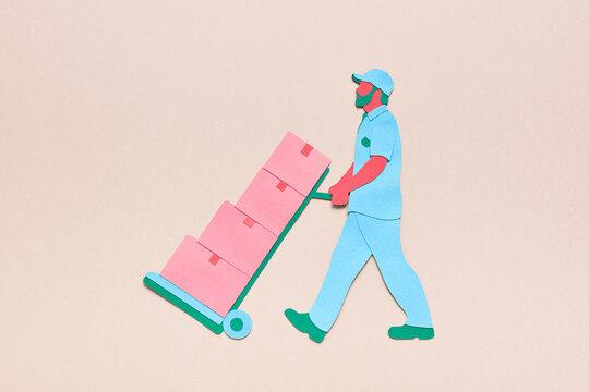 Delivery man pushing box cart