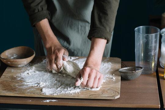 Closeup Of Man's Hands Making Homemade Asian Dumplings
