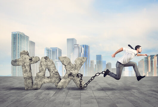 Businessman tries to escape from taxes but he is tied strong with the chain