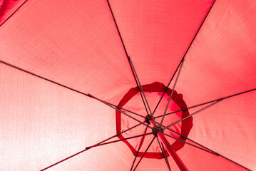 Fabric of an intense red umbrella.