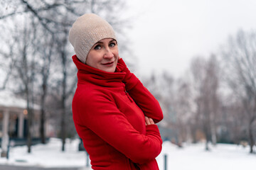 Beautiful Mature Woman In Red Bright Sportswear After Jogging And Running Outdoors With Park At Background. Active and Healthy Lifestyle at Middle Age