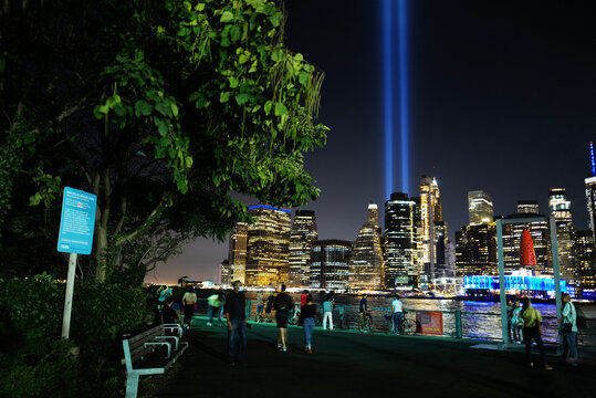 Sept 11, 2020 People taking pictures with  9/11 Memorial Lights at Brooklyn Bridge Park, New York City, USA.