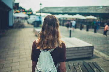 Young woman walkingin a city
