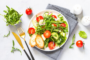 Green salad from leaves and vegetables.