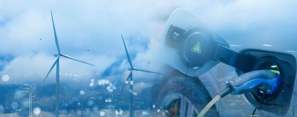 Double exposure of EV electric car charge battery and wind turbine, uses nature electric energy to generate electricity. Bokeh blur light building cityscape panoramic on background. Green eco concept.