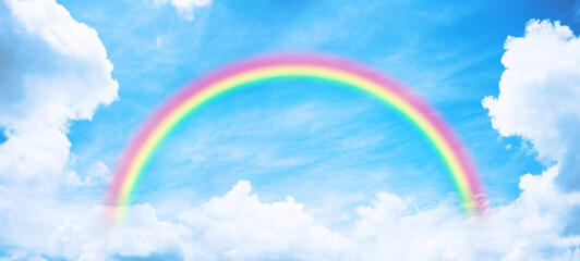 Rainbow in blue sky.