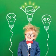 Bright idea! Happy geek against green chalkboard