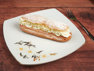 Traditional french eclair with whipped cream
