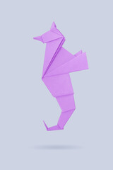 Abstract origami sea horse isolated on a gray backgrounds