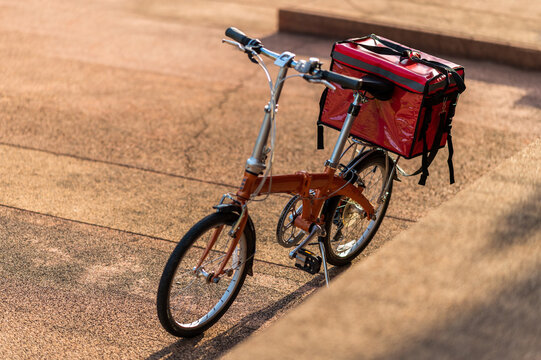 A red bag placed on a bicycle preparing to deliver parcels to customers