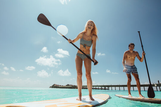 Couple enjoying standup paddleboarding
