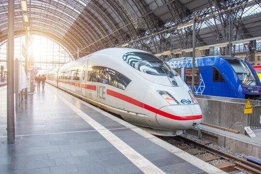 Deutsche Bahn ICE 3 train stopping at platform Hauptbahnhof Central Station. Germany, Frankfurt am Main. 14 December 2019.