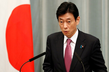 Japan's Minister in charge of economic revitalisation and measures for the novel coronavirus pandemic Yasutoshi Nishimura attends a news conference in Tokyo