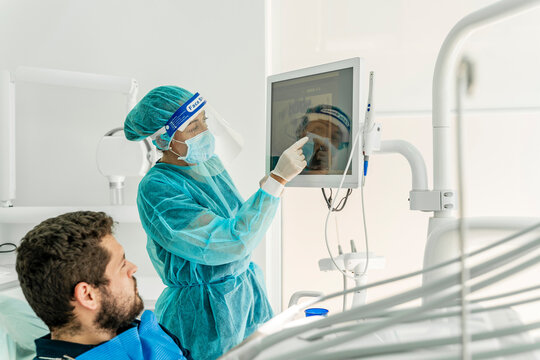 Female doctor talking to patient in dentist's clinic