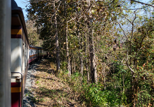 The express train is going to the hilltop  along with the mountain range.