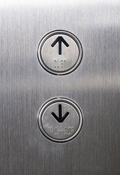 Arrow symbol with the braille on the push button.