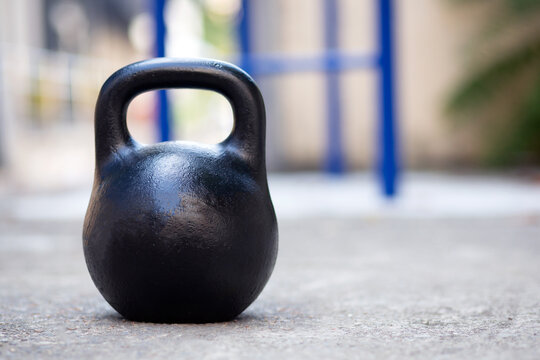 Kettlebell for sports. Big black kettlebell outside.