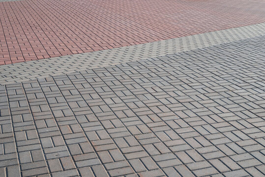 Perspective view of gray and red paving slabs.