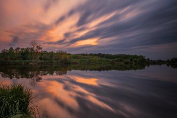 Long exposure fantastic sunset view on Bartatov Bartativ, Morozy village region Lviv. Lake and forest. Lviv district, Ukraine. May 2020