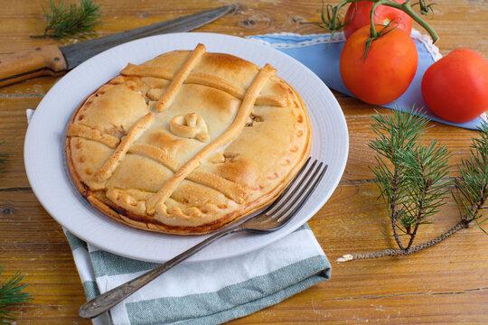 Empanada de atun, Traditional pie stuffed with tuna fish typical from Galicia, Spain.