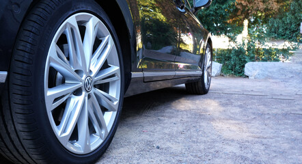 VW (Volkswagen), lower side view with light alloy rims and tires